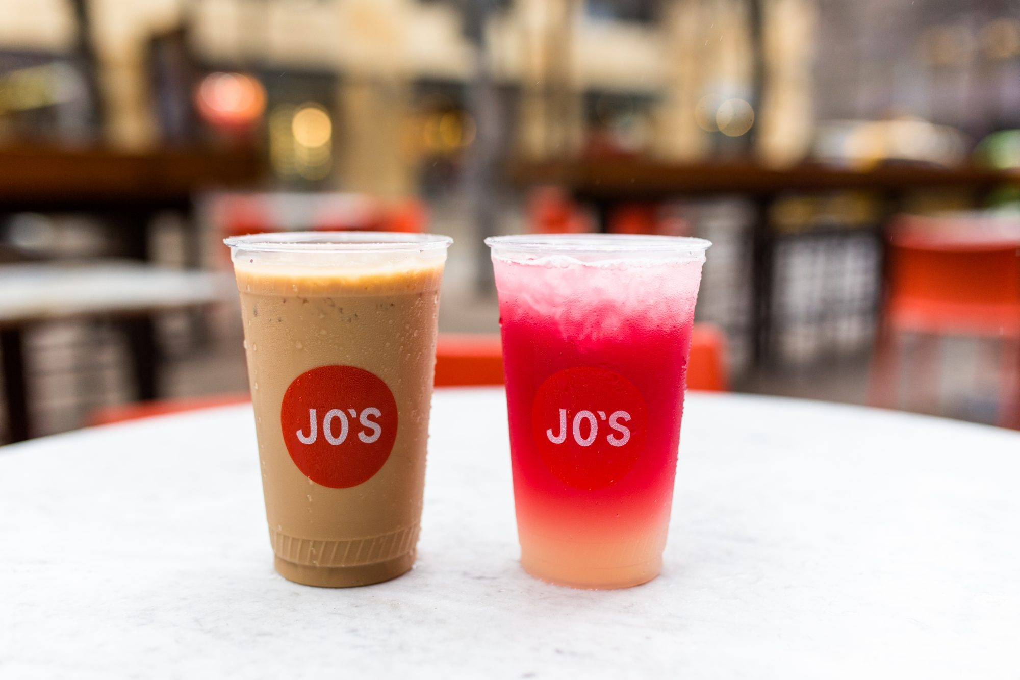 Two iced drinks with the Jo's diner logo